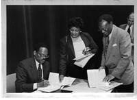 Dr. Audrey Harrigan, Professor Roy McLeod and Dr. William Julius Wilson - signing book autographs