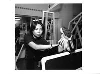 A student exercises in the gym